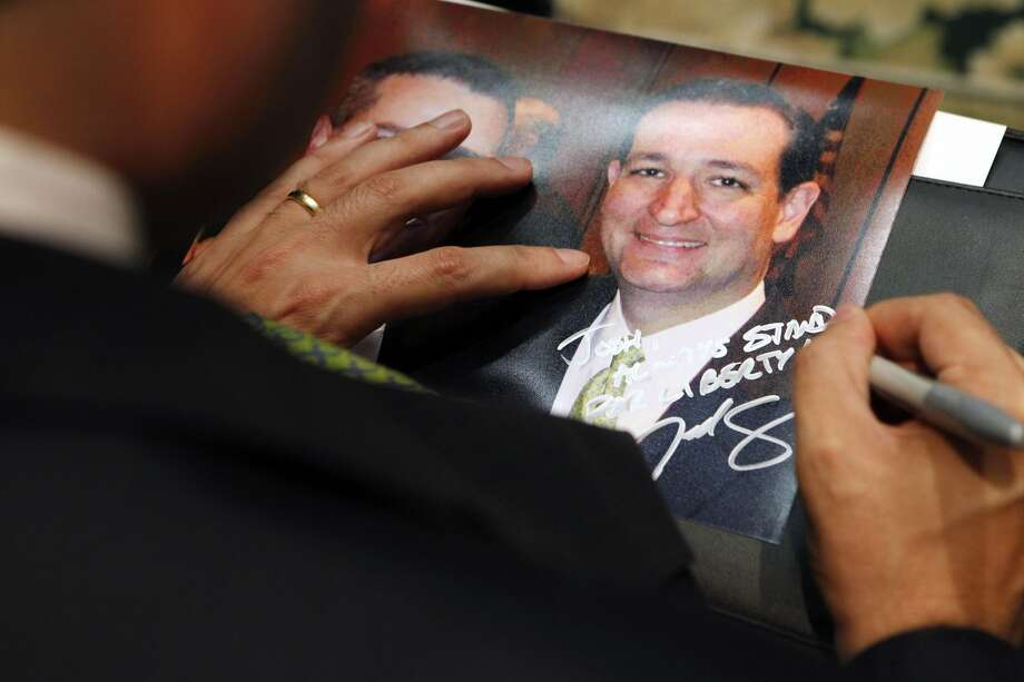 U.S. Senate candidate Ted Cruz signs a picture of himself after speaking to the Texas delegation at the Saddlebrook Resort in Wesley Chapel, Florida on Monday, August 27, 2012. (Lara Solt/Dallas Morning News/MCT) (Lara Solt / McClatchy-Tribune News Service)