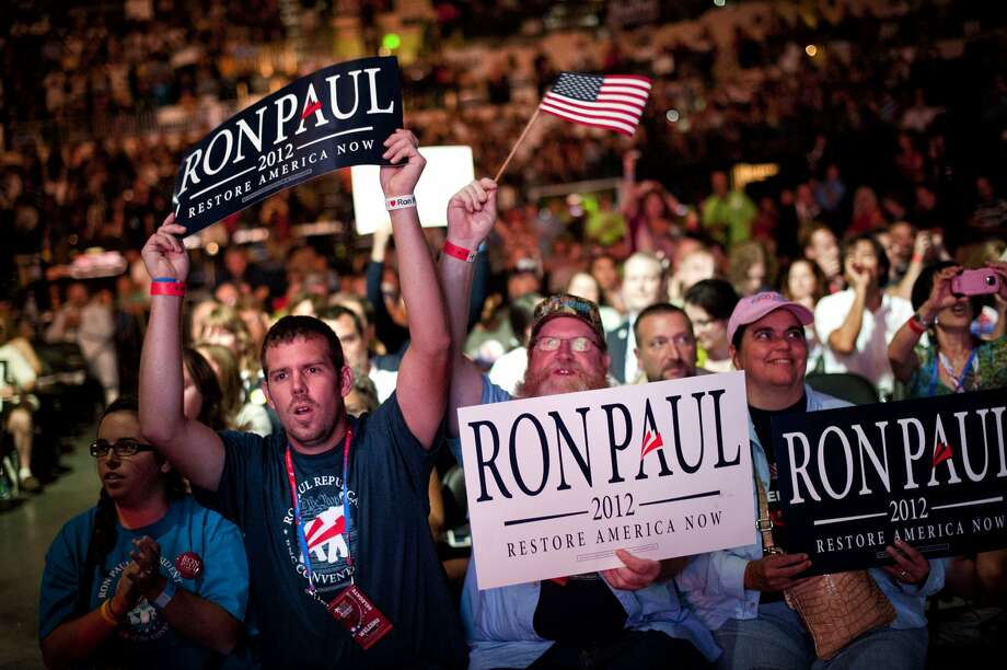 Philip Eby and Brian Rockey of Texas cheered singer John Popper during a Ron Paul Rally at the Sun Dome in Tampa, Florida on Sunday, August 26, 2012. (Glen Stubbe/Minneapolis Star Tribune/MCT) (Glen Stubbe / McClatchy-Tribune News Service)