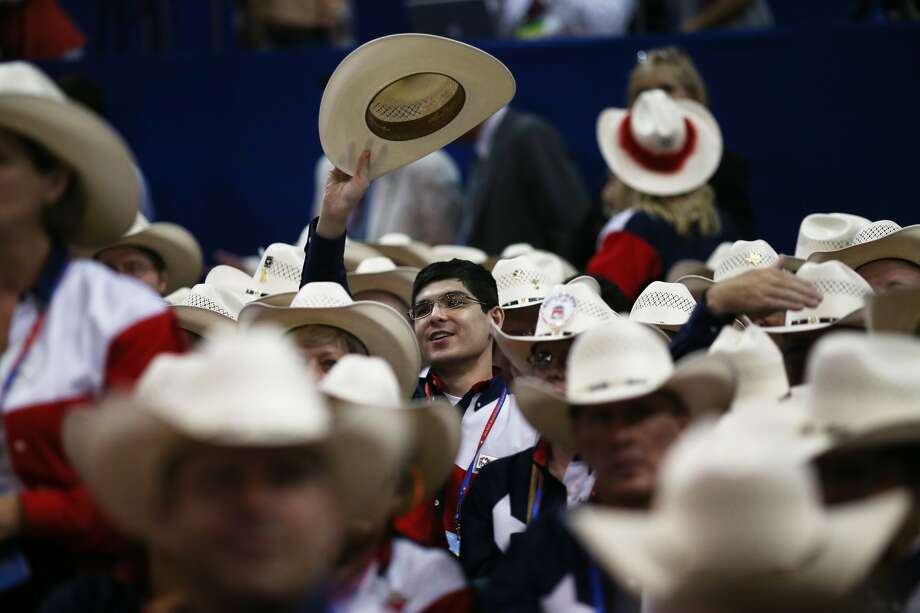 TAMPA, FL - AUGUST 28:  A man from the Texas delegation waves his cowboy hat during the Republican National Convention at the Tampa Bay Times Forum on August 28, 2012 in Tampa, Florida. Today is the first full session of the RNC after the start was delayed due to Tropical Storm Isaac.  (Spencer Platt/Getty Images) (Spencer Platt / Getty Images)