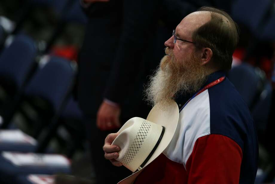 TAMPA, FL - AUGUST 28:  A man from the Texas delegation places his cowboy hat over his chest during the second day of the Republican National Convention at the Tampa Bay Times Forum on August 28, 2012 in Tampa, Florida. Today is the first full session of the RNC after the start was delayed due to Tropical Storm Isaac.  (Mark Wilson/Getty Images) (Mark Wilson / Getty Images)