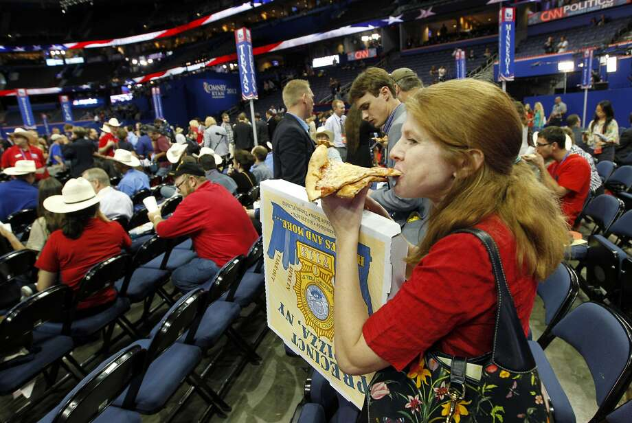 Texas alternate delegate Stephanie Claghorn of Copperas Cove, Texas enjoys some pizza following the shortened first session of the Republican National Convention at the Tampa Bay Times Forum in Tampa, Florida on Monday, August 27, 2012. After some opening remarks by RNC chairman Reince Priebus and an invocation, the session was in recess until Tuesday afternoon. (Tom Fox/Dallas Morning News/MCT) (Tom Fox / McClatchy-Tribune News Service)