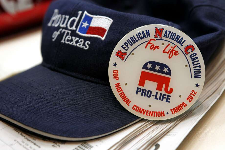 A hat and pin on the table during the Texas delegation meeting at the Saddlebrook Resort in Wesley Chapel, Florida on Monday, August 27, 2012. (Lara Solt/Dallas Morning News/MCT) (Lara Solt / McClatchy-Tribune News Service)