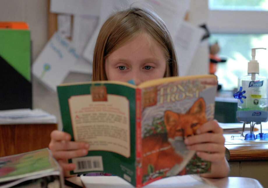To combat low test scores throughout the San Antonio area, a reader has a suggestion for young students -- read book after book after book. Photo: Allison Love, Associated Press / Chattanooga Times Free Press