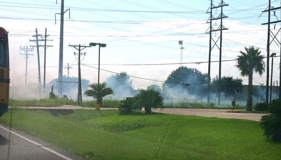 A grass fire burns Tuesday afternoon on the westbound frontage road along Highway 73, just beyond the United Methodist Temple in Port Arthur. Photo: Courtesy Photo
