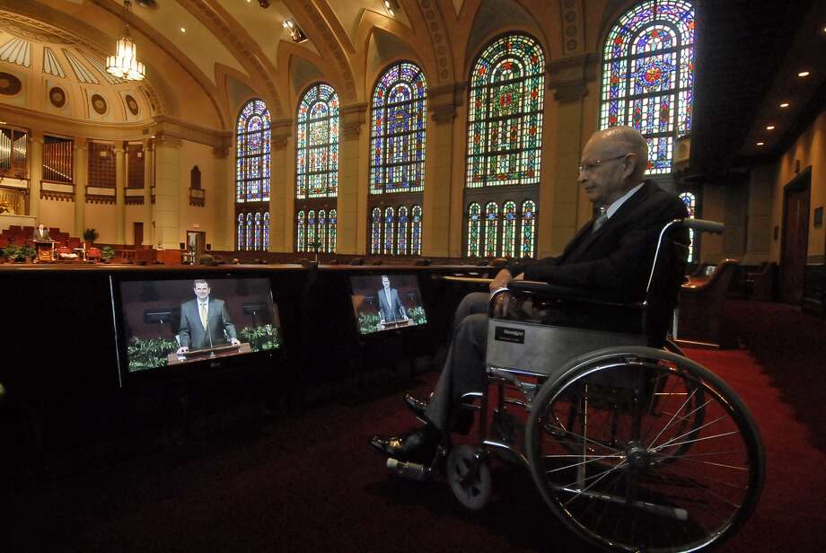 Gordon King (church deacon and head usher for the 8:30 service) poses in a wheelchair in front of the video screens set up in the back of the South Main Baptist Church sanctuary. The video screens are designed to help wheelchair bound visitors view the service when parisoners stand during the service. The Reverand Steve Wells is on the monitors. Photographed Sunday 8/05/12. Photo by Tony Bullard. Photo: Tony Bullard / © Tony Bullard & the Houston Chronicle