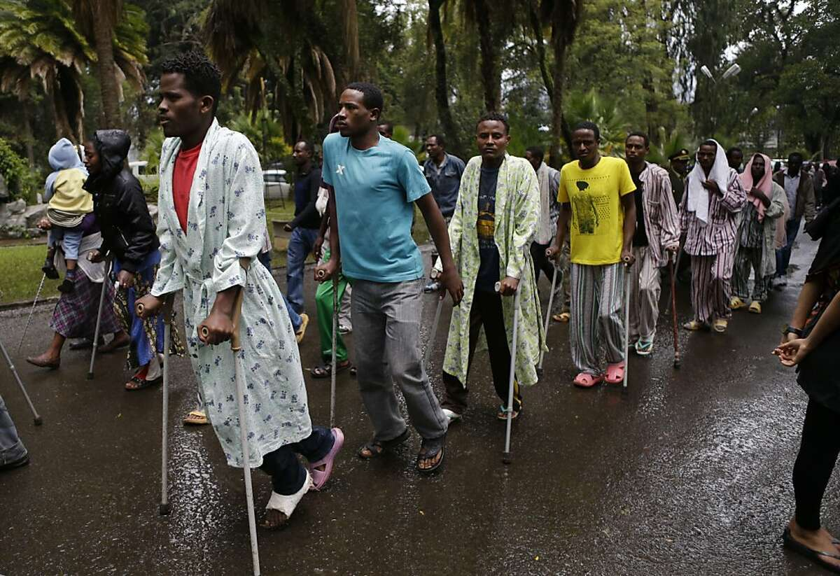 Men and women from a community of people with physical disabilities arrive to pay their respects at the coffin of Prime Minister Meles Zenawi, at the prime minister's official residence the national palace, in Addis Ababa, Ethiopia Saturday, Aug. 25, 2012. In an emotional outpouring of national grief, Ethiopians continued to line up by the thousands Saturday to pay their respects to Zenawi, who died Monday, Aug. 20 of an unknown illness. Zenawi is scheduled to be buried on Sept. 2. (AP Photo/Rebecca Blackwell)