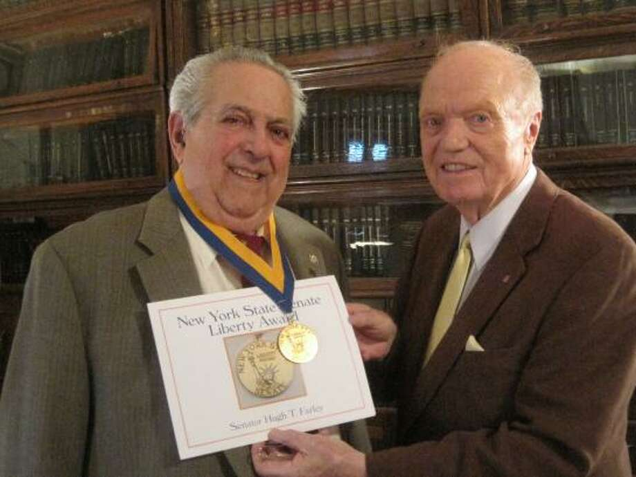 Schenectady attorney Albie Ferrucci and Sen. Hugh Farley are shown in Ferrucci's law office where he was presented with the New York State Senate Liberty Medal, the New York State Medal for Merit and the New York State Conspicuous Service Star. (Photo provided by office of Sen. Hugh Farley)