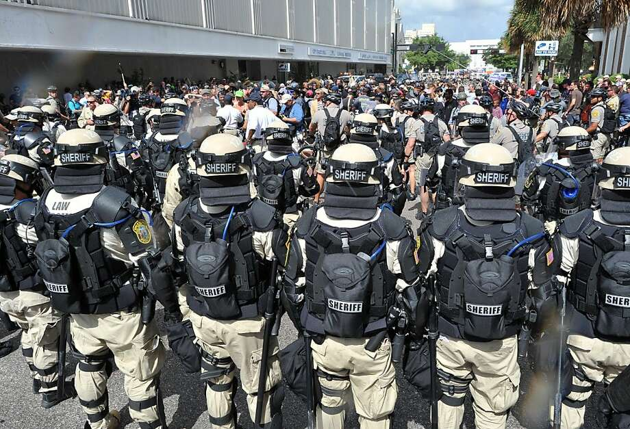 Police in riot gear stop an anti-GOP march from approaching the Tampa Bay Times Forum during a protest rally in Tampa, Florida on August 28, 2012. The 2012 Republican National Convention is expected to host 2,286 delegates and 2,125 alternate delegates from all 50 states, the District of Columbia and five territories. Photo: Mladen Antonov, AFP/Getty Images