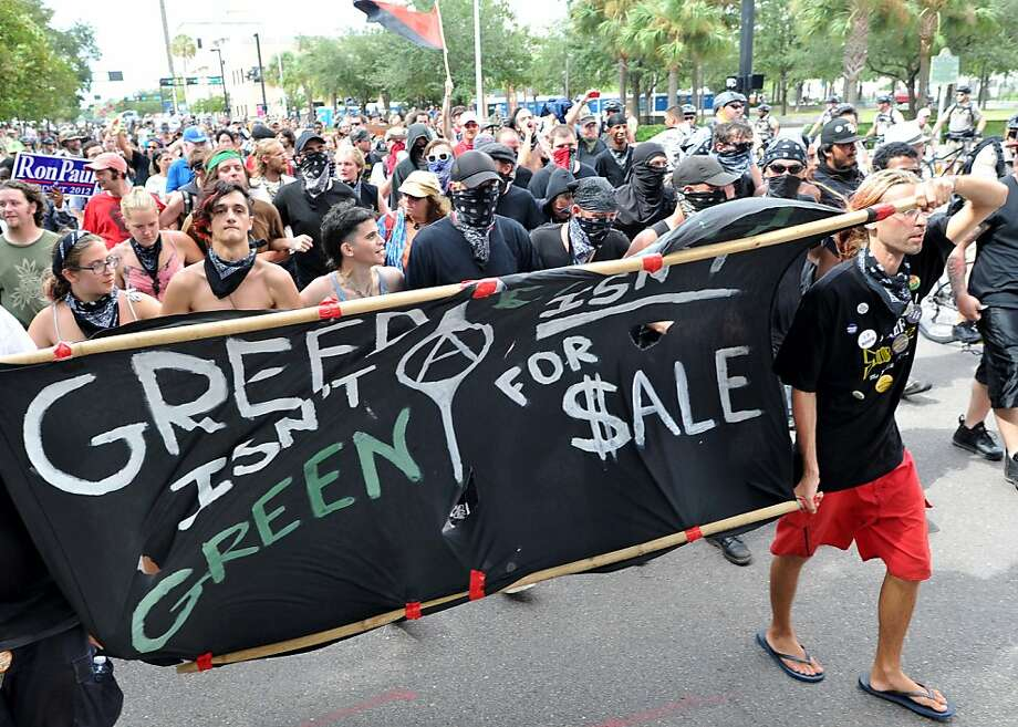 Anti-GOP protesters march on the streets in downtown Tampa, Florida on August 28, 2012. The 2012 Republican National Convention is expected to host 2,286 delegates and 2,125 alternate delegates from all 50 states, the District of Columbia and five territories. Photo: Mladen Antonov, AFP/Getty Images
