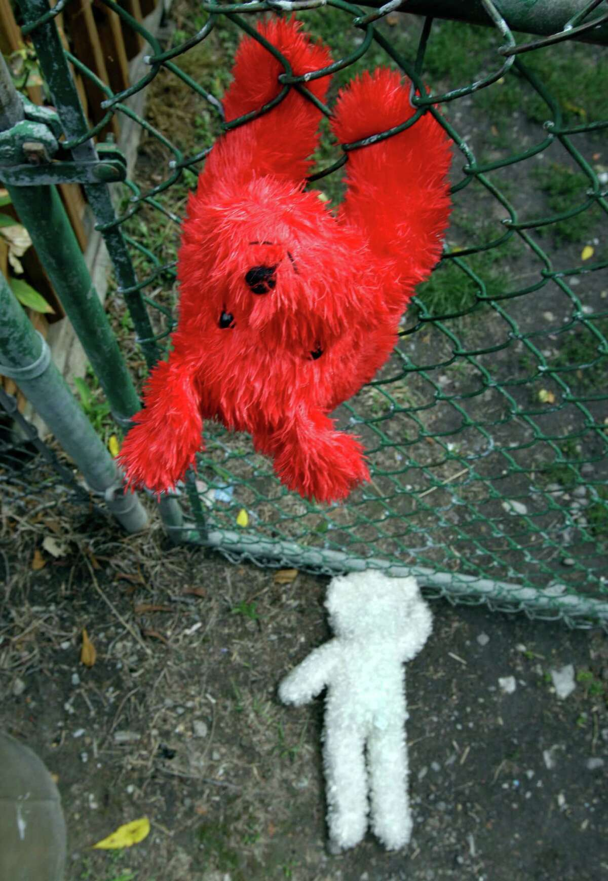 Memorial stuffed animals are shown near the back gate of a home where 5-year-old Isabella Sarah Tennant had been staying with a relative in Niagara Falls, N.Y., Tuesday, Aug. 28, 2012. Authorities said 16-year-old John Freeman and 18-year-old Tyler Best are scheduled to be arraigned Tuesday morning in Niagara Falls City Court in connection with the death of the 5-year-old New York girl. Police have charged Freeman as an adult, and he faces a murder charge. Best is charged with tampering with evidence.