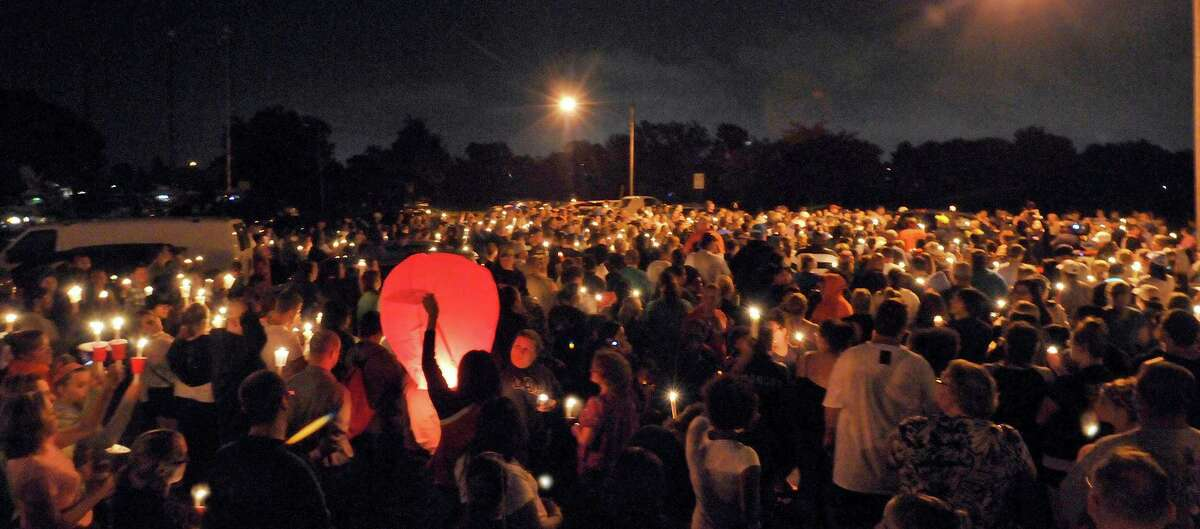 Hundreds attend a candlelight vigil in Hyde Park for five-year-old Isabella Sarah Tennant Monday, Aug. 27, 2012 in Niagra Falls, N.Y. Authorities said 16-year-old John Freeman and 18-year-old Tyler Best are scheduled to be arraigned Tuesday morning in Niagara Falls City Court in connection with the death of the 5-year-old New York girl. Police have charged Freeman as an adult, and he faces a murder charge. Best is charged with tampering with evidence. (AP Photo/The Niagara Gazette, Dan Cappellazzo) BUFFALO NEWS OUT; BATAVIA DAILY NEWS OUT