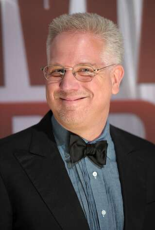 "Glenn Beck's ratings on Fox News soared during the springtime of the Tea Party, but later sank like a stone.  He's no longer on Fox.  Beck is Mt. Vernon, Wash., native who received keys to the city four years ago.  Outside the hall, demonstrators held banner saying:  ""Change the locks."" (Michael Loccisano / Getty Images)"