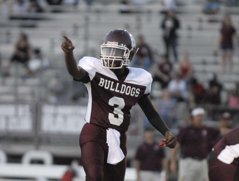 Reagan quarterback Tyron Washington is back to lead the Bulldog attack, which will be challenged indeed against powerful Class 5A foe Westside in the opener Saturday. Photo: Tony Bullard / Credit: for the Chronicle