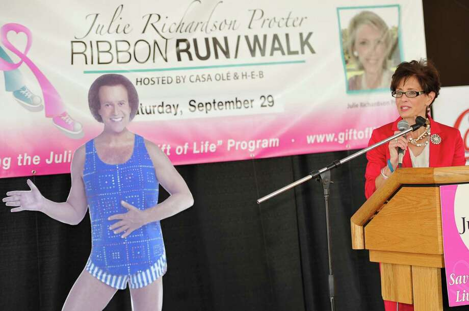"Norma Sampson, right, announces that Richard Simmons, left, internationally recognized fitness expert will be a guest at the Julie Richardson Procter Ribbon Run/Walk held Saturday September 29, 2012 and the picnic afterwards. The Julie Rogers Gift of Life held their ""Putting on the Pink"" press conference Tuesday August 28, 2012 outside the Beaumont Civic Center. Dave Ryan/The Enterprise Photo: Dave Ryan"