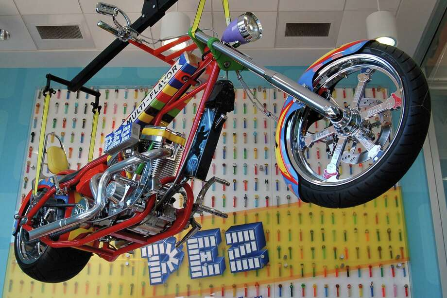 At the PEZ Visitor Center in Orange, a motorcycle (designed by Orange County Choppers of California) hangs from the ceiling. Photo: DAVID W. KEYES/STAFF PHOTO