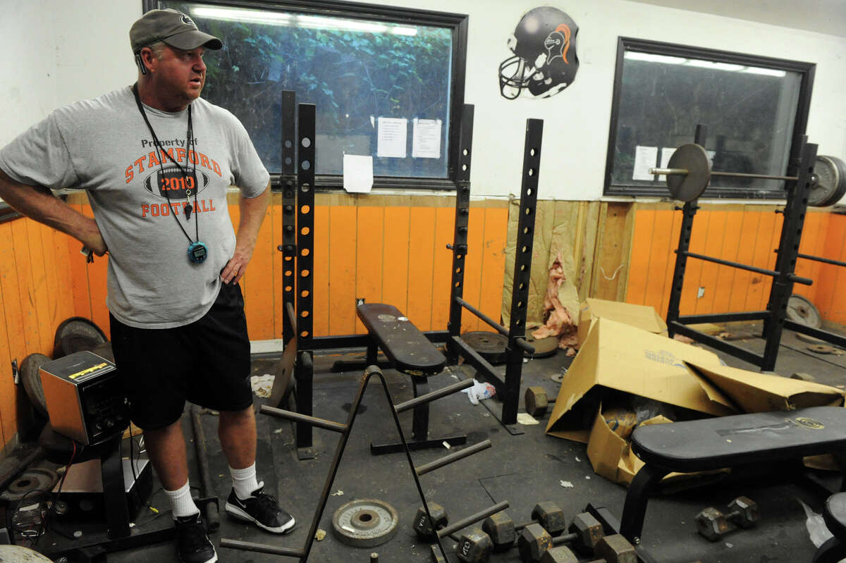 Coach Bryan Hocter looks over the Stamford High School football team's weight room which is condemned and has not been useable for the past couple of years, it is beneath the bleachers in Boyle Stadium in Stamford, Conn., August 28, 2012.