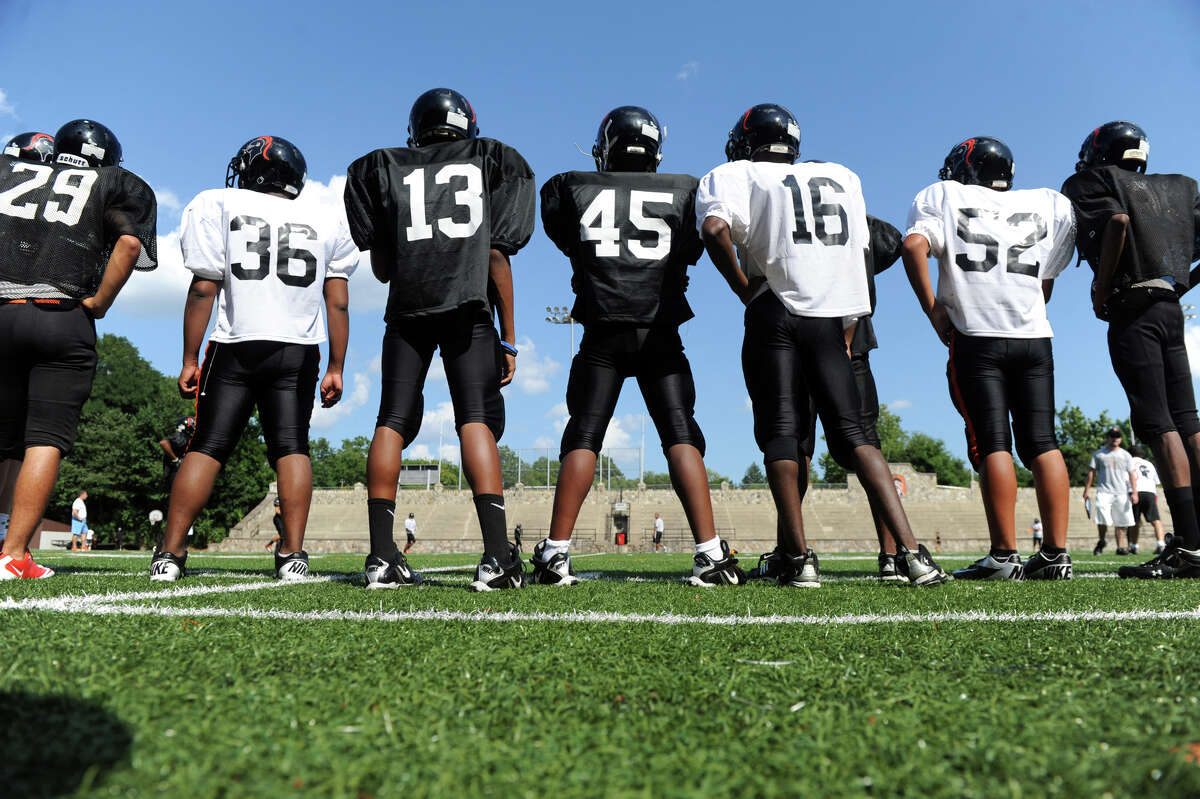 The Stamford High School football team works out on the new turf field in Boyle Stadium in Stamford, Conn., August 28, 2012.
