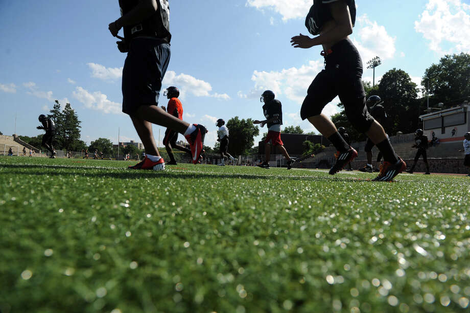 The Stamford High School football team works out on the new turf field in Boyle Stadium in Stamford, Conn., August 28, 2012. Photo: Keelin Daly / Stamford Advocate