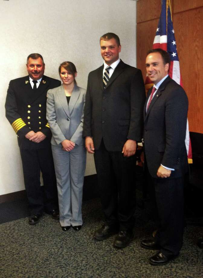 Fire Chief Peter Siecienski, new Greenwich firefighters Lisa Constantino and Michael Jedd, and First Selectman Peter Tesei at the swearing in for Constantino, Jedd, and fire marshal James McDonald at Town Hall in Greenwich, Conn. on Tuesday, Aug. 28, 2012. Photo: Contributed Photo / Greenwich Time Contributed