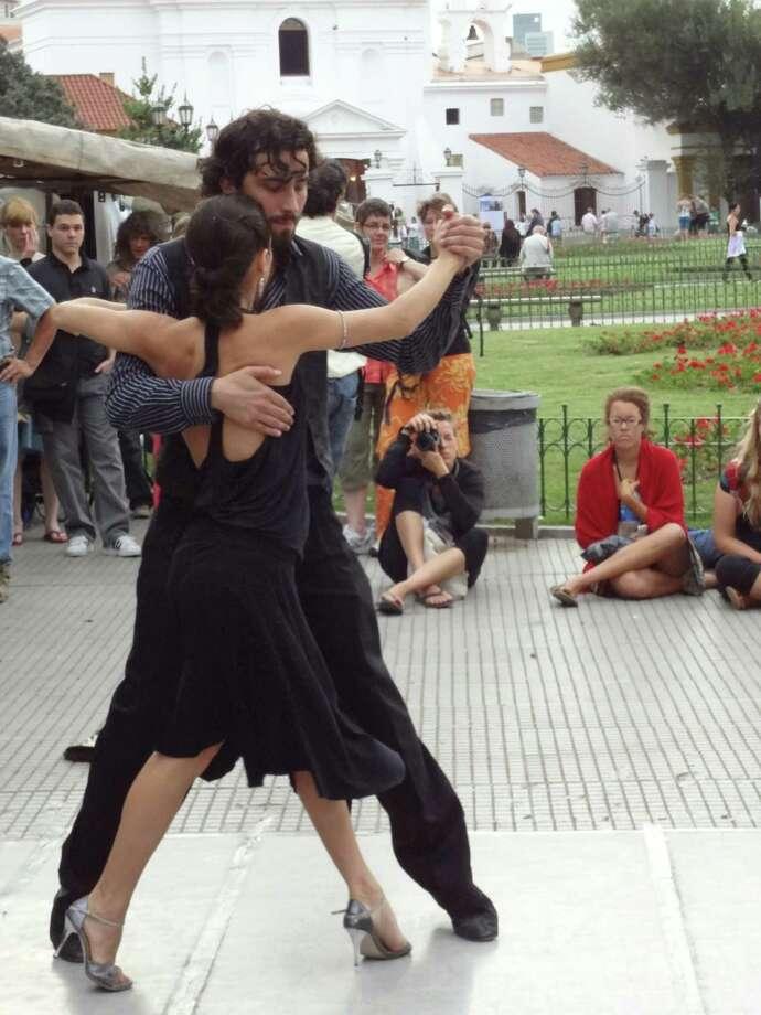 Tango dancers outside the Feria de Plaza Francia, Buenos Aires. Photo: Sarah Sumadi, For The Express-News