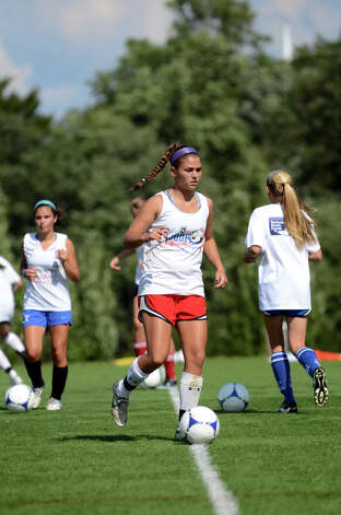 Darien girls soccer goalie Phoebe Tayler runs a drill during soccer practice at Darien High School on Tuesday, Aug. 28, 2012. Photo: Amy Mortensen / Connecticut Post Freelance