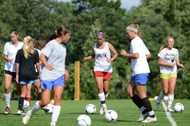 Darien girls soccer goalie Phoebe Taylor, in red shorts, runs a drill during soccer practice at Darien High School on Tuesday, Aug. 28, 2012. Photo: Amy Mortensen / Connecticut Post Freelance