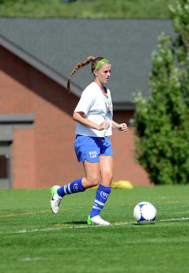 Darien girls soccer captain Parker Hamill runs a drill during soccer practice at Darien High School on Tuesday, Aug. 28, 2012. Photo: Amy Mortensen / Connecticut Post Freelance