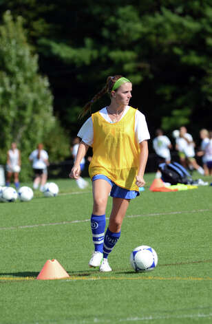 Darien girls soccer captain Parker Hamill controls the ball during soccer practice at Darien High School on Tuesday, Aug. 28, 2012. Photo: Amy Mortensen / Connecticut Post Freelance