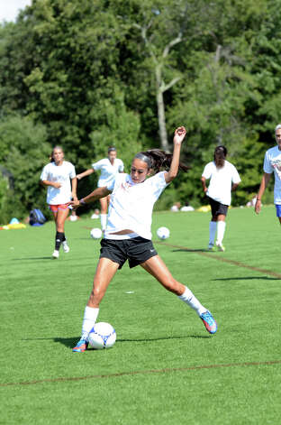 Darien girls soccer captain Vanessa Budd runs a drill during soccer practice at Darien High School on Tuesday, Aug. 28, 2012. Photo: Amy Mortensen / Connecticut Post Freelance