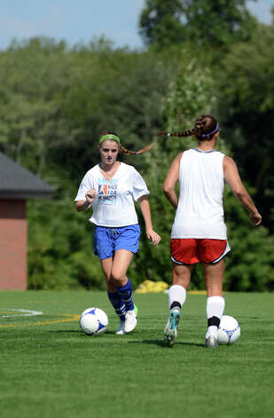 Darien girls soccer captain Parker Hamill, left, runs a drill alongside goalie Phoebe Taylor during soccer practice at Darien High School on Tuesday, Aug. 28, 2012. Photo: Amy Mortensen / Connecticut Post Freelance