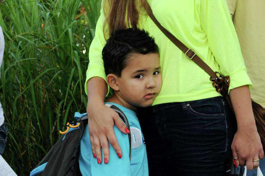 Charles Moreira, 4, hugs his mother Camila before going to kindergarten at New Lebanon School's first day of school in Byram Tuesday, Aug. 28, 2012. Photo: Helen Neafsey / Greenwich Time