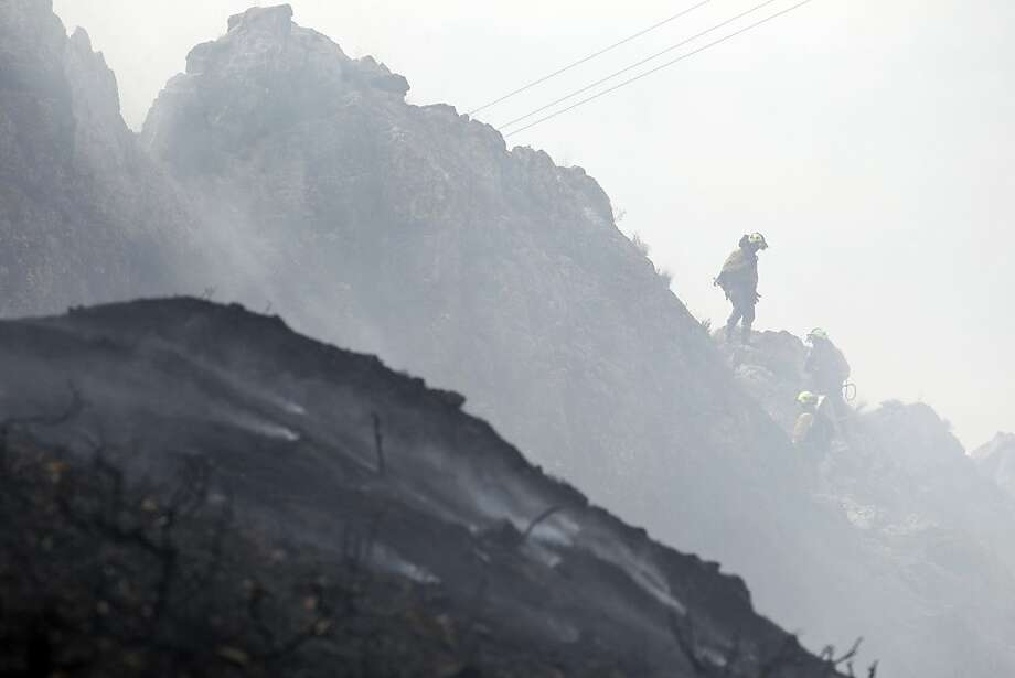 Firefighters work at the site of a wildfire in Talamantes, near Zaragoza on August 28, 2012. Numerous wildfires have broken out across Spain in the sweltering heat in recent weeks, an extra headache for authorities struggling to get the country out of its financial crisis and recession.  Photo: Cesar Manso, AFP/Getty Images