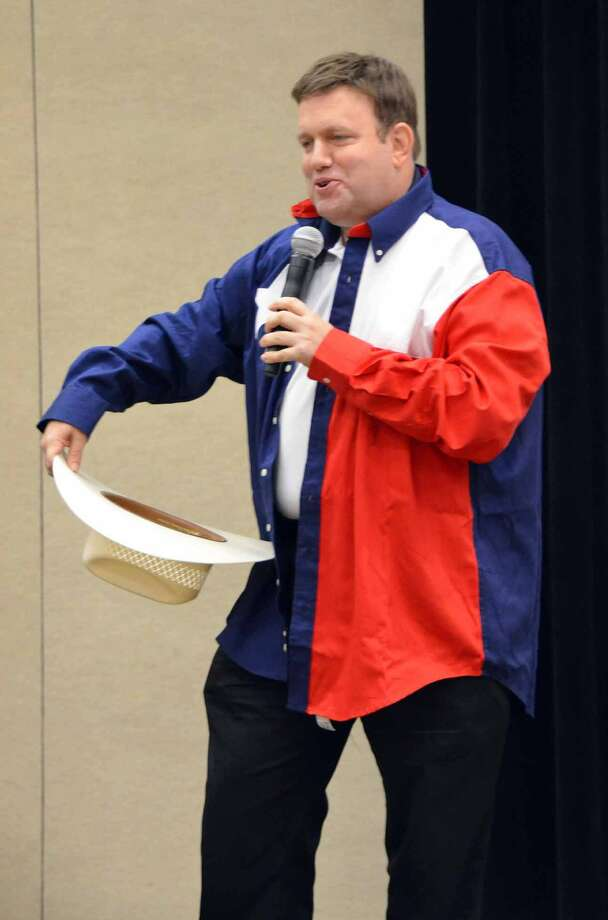 GOP pollster Frank Luntz was outfitted with Texas garb while advising state Republicans on how to communicate an anti-Obama message. (Jennifer A. Dlouhy / Houston Chronicle)