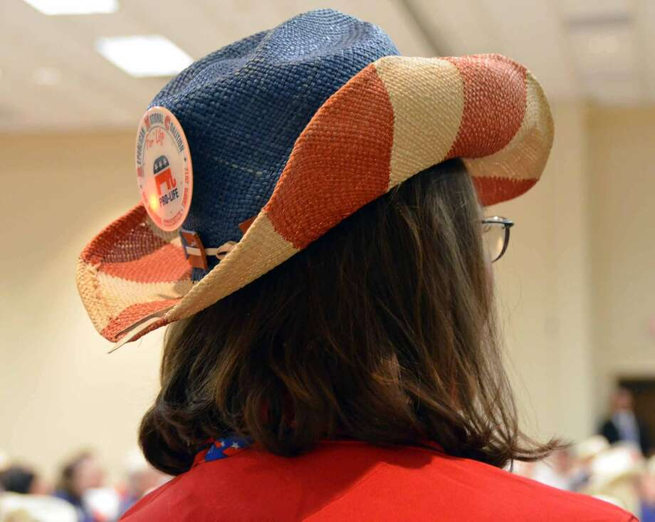 An RNC delegate shows off her national and Texas pride with a colorful cowboy hat. (Jennifer A. Dlouhy / Houston Chronicle)