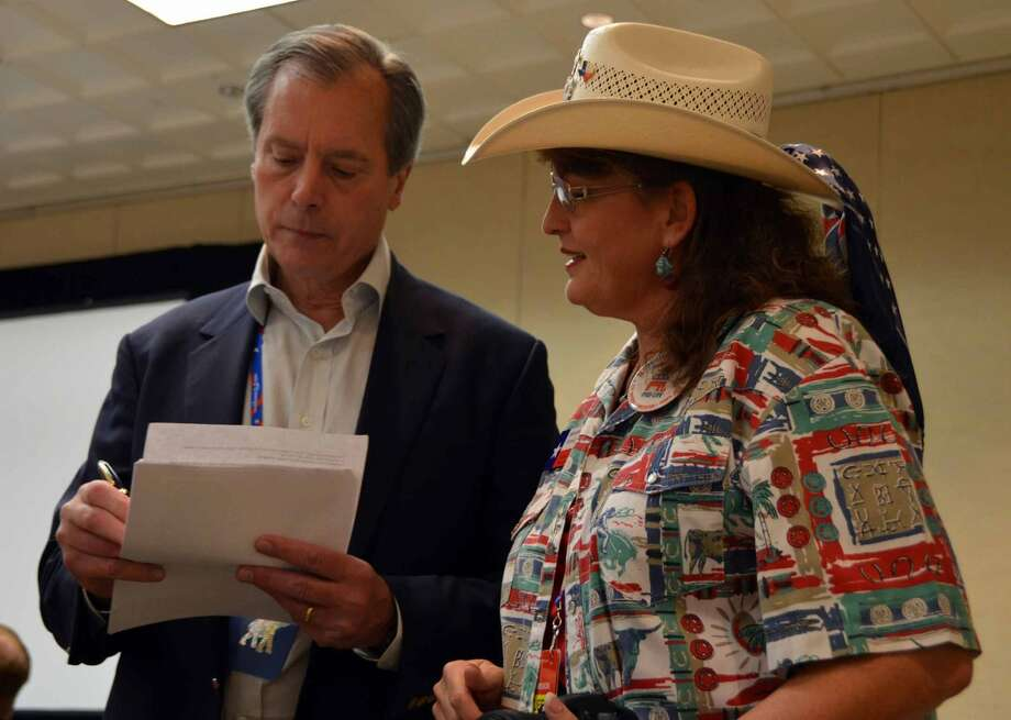 Texas Lt. Gov. David Dewhurst talks to a supporter after speaking to Texans at the Republican National Convention in Tampa. (Jennifer A. Dlouhy / Houston Chronicle)