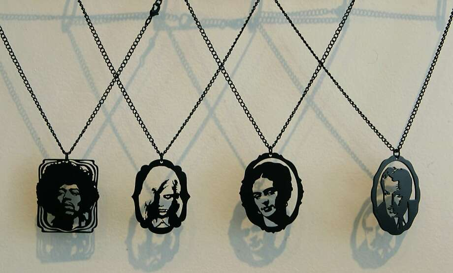 Necklaces of famous figures made from black metal are displayed at De Frisco Regalia jewelry and gift shop in San Francisco, Calif. on Saturday, Aug. 25, 2012. Photo: Paul Chinn, The Chronicle
