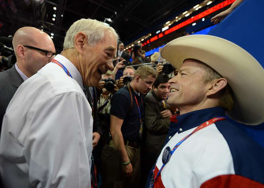 Republican presidential candidate Ron Paul (L) speaks to a supporter from Texas at the Tampa Bay Times Forum in Tampa, Florida, on August 28, 2012 during the Republican National Convention. The 2012 Republican National Convention is expected to host 2,286 delegates and 2,125 alternate delegates from all 50 states, the District of Columbia and five territories. AFP PHOTO Robyn BECKROBYN BECK/AFP/GettyImages (ROBYN BECK / AFP/Getty Images)