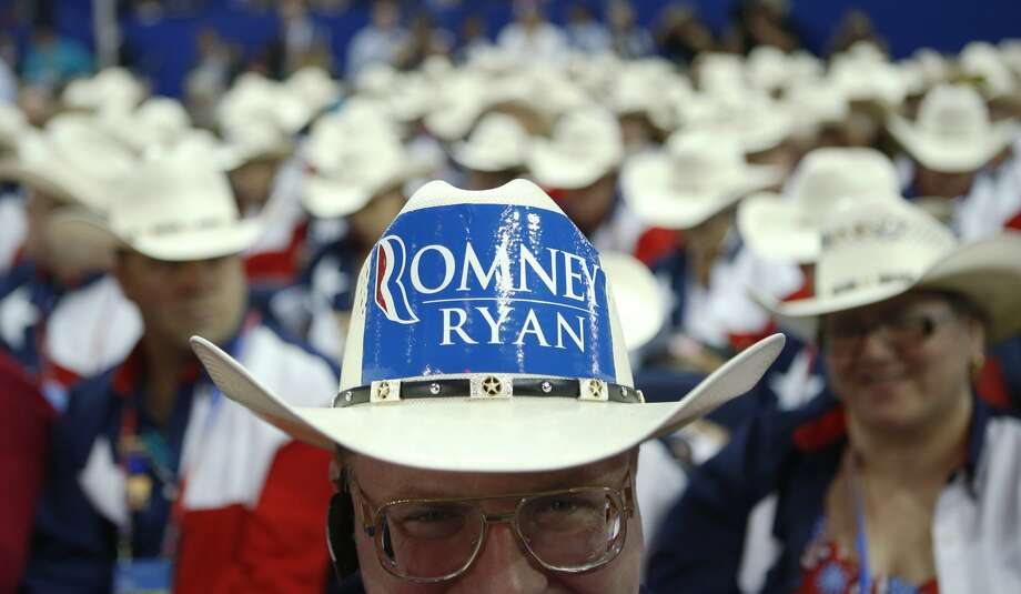 Texas delegate Clint Moore and the rest of Texas delegates fashion their cowboy hats at the Republican National Convention in Tampa, Fla., on Tuesday, Aug. 28, 2012. (Jae C. Hong/AP) (Jae C. Hong / Associated Press)