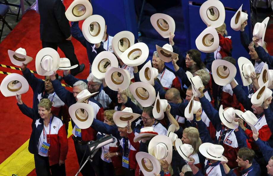Members of the Texas delegation tip their hats in unison at the Republican National Convention at the Tampa Bay Times Forum in Tampa, Florida, Tuesday, August 28, 2012. (Louis DeLuca/Dallas Morning News/MCT) (Louis DeLuca / McClatchy-Tribune News Service)