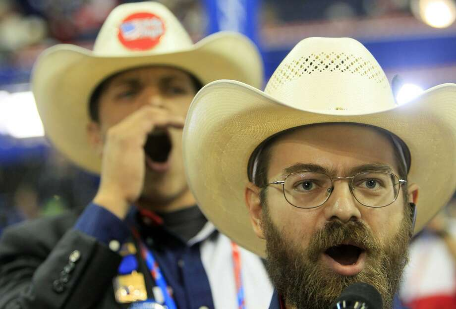"Texas delegates Jeremy Blosser, foreground, and Luis Larotta chant ""point of order"" at the Republican National Convention at the Tampa Bay Times Forum in Tampa, Florida, Tuesday, August 28, 2012. (Dirk Shadd/Tampa Bay Times/MCT)  (Dirk Shadd / McClatchy-Tribune News Service)"