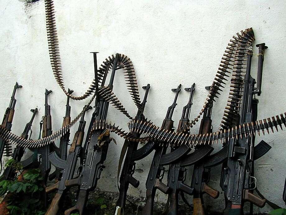 Kalashnikov assault rifles and a couple of machine guns are shown in a market in Mogadishu, Somalia. Photo: Osman Hassan