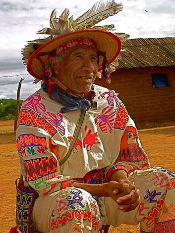 Pablo, an elder shaman in the Huichol village of San Andres Coamihata, wears a straw hat covered with feathers. Photo: Maribeth Mellin