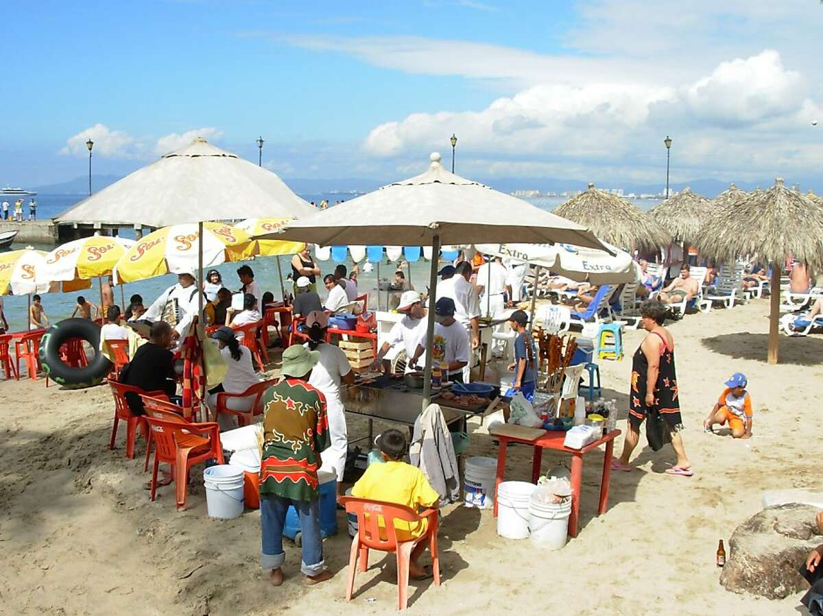 Locals and visitors gather on the beach.