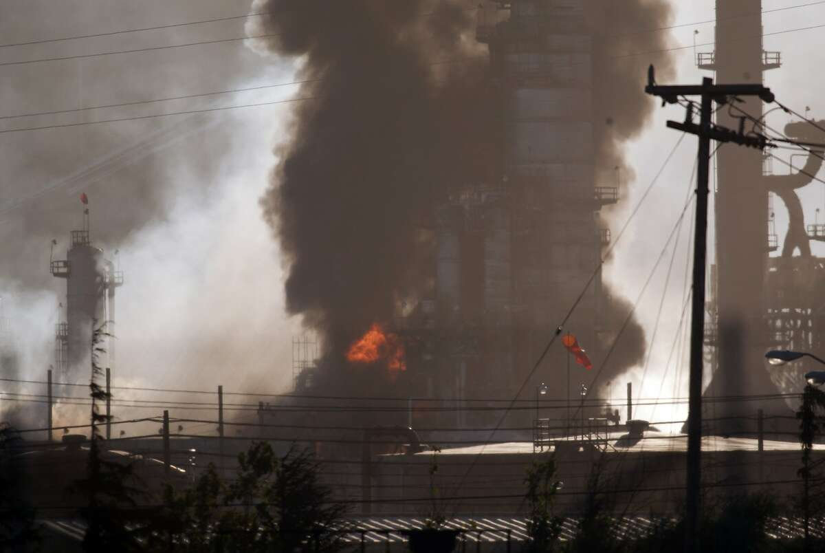 Smoke and flame billow from a crude oil unit at the Chevron refinery in Richmond, Calif., Monday, Aug. 6, 2012. The facility makes high-quality products that include gasoline, jet fuel, diesel fuel and lubricants, as well as chemicals used to manufacture many other products.