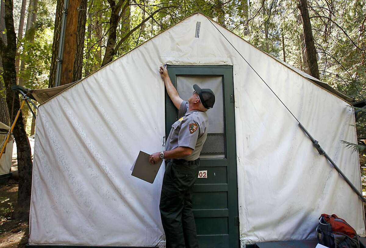 Glenn Dean, a National Parks Occupational Safety and Health Specialist inspects tent cabins for mice entry points, at Curry Village at Yosemite National Park on Tuesday August 28, 2012. Four people have been infected with the hantavirus, two of which have died while staying at the Curry Village tent cabins at Yosemite National Park in California.