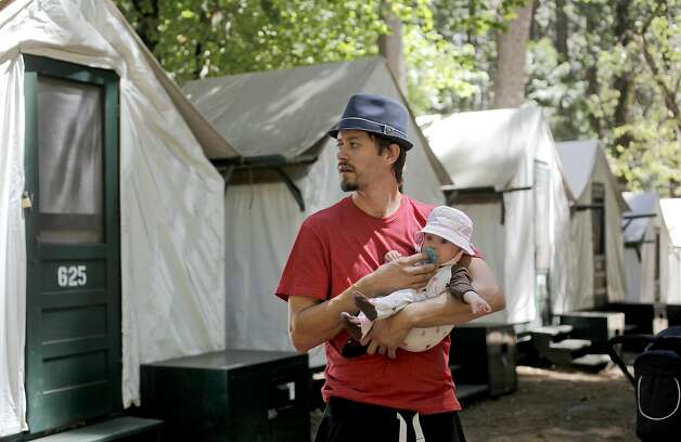 David De Grandpre with his 3-month-old daughter, Jade, on Tuesday August 28, 2012, is staying four nights in the tent cabins at Curry Village at Yosemite National Park with his wife, Jessica Beaulieu. He says they are washing their hands more frequently since finding out about the hantavirus detected in the area.  Four people have been infected with the hantavirus, two of which have died while staying at the Curry Village tent cabins at Yosemite National Park in California. Photo: Michael Macor, The Chronicle