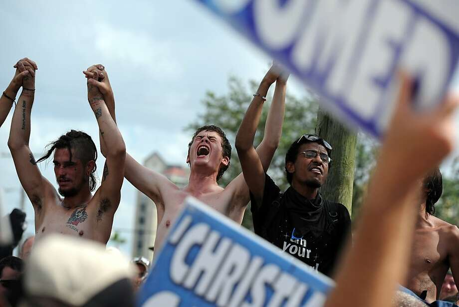 Protesters taunt demonstrators from the conservative Westboro Baptist Church outside the convention. Photo: Tiffany Tompkins-Condie, McClatchy-Tribune News Service
