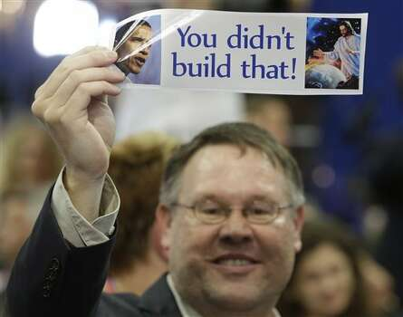 North Carolina delegate Ken Nelson from Charlotte holds up a bumper sticker at the Republican National Convention in Tampa, Fla., on Tuesday, Aug. 28, 2012. (AP Photo/Charles Dharapak) (AP)