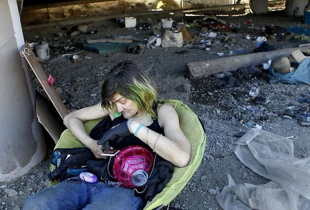 Brenda Clark, who lived at the encampment for months, sat in a chair and tried to decide where to go next. A longtime homeless encampment on Caltrans property at 5th and King Streets in San Francisco, Calif. was cleared of homeless and cleaned up by state and local authorities Tuesday August 28, 2012. Photo: Brant Ward, The Chronicle