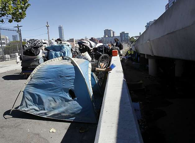 The belongings of homeless people were gathered up on a nearby street so cleanup could begin. A longtime homeless encampment on Caltrans property at 5th and King Streets in San Francisco, Calif. was cleared of homeless and cleaned up by state and local authorities Tuesday August 28, 2012. Photo: Brant Ward, The Chronicle
